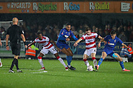 AFC Wimbledon defender Terell Thomas (6) and AFC Wimbledon midfielder Callum Reilly (33) battles for possession with Doncaster Rovers midfielder Ben Sheaf (6) during the The FA Cup match between AFC Wimbledon and Doncaster Rovers at the Cherry Red Records Stadium, Kingston, England on 9 November 2019.