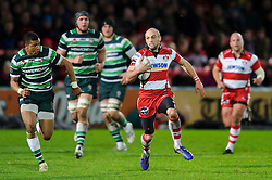 Gloucester Winger (#14) Charlie Sharples breaks cross field with London Irish Winger (#11) Anthony Watson in persuit during the second half of the match - Photo mandatory by-line: Rogan Thomson/JMP - Tel: Mobile: 07966 386802 15/12/2012 - SPORT - RUGBY - Kingsholm Stadium - Gloucester. Gloucester Rugby v London Irish - Amlin Challenge Cup Round 4.