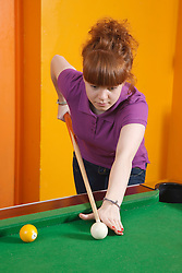 Girl playing pool in Youth Club. Cleared for Mental Health Issues.