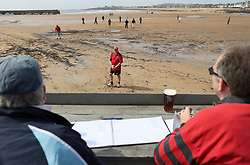 Embargoed to 0001 Monday August 28 People watch a match between the Ship Inn Cricket Club and the Eccentric Flamingoes Cricket Club on Sunday April 30th, 2017, in front of the pub in Elie, Fife, which is the only one in Britain to have a cricket team with a pitch on the beach. The Ship Inn Cricket Club season runs from May to September with dates of matches dependent on the tides. Any Batsman who hits a six which lands in the Ship Inn beer garden wins their height in beer and any spectator who catches a six in the beer garden also wins their height in beer.