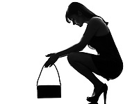 stylish silhouette caucasian beautiful woman crouching thinkig despair full length on studio isolated white background
