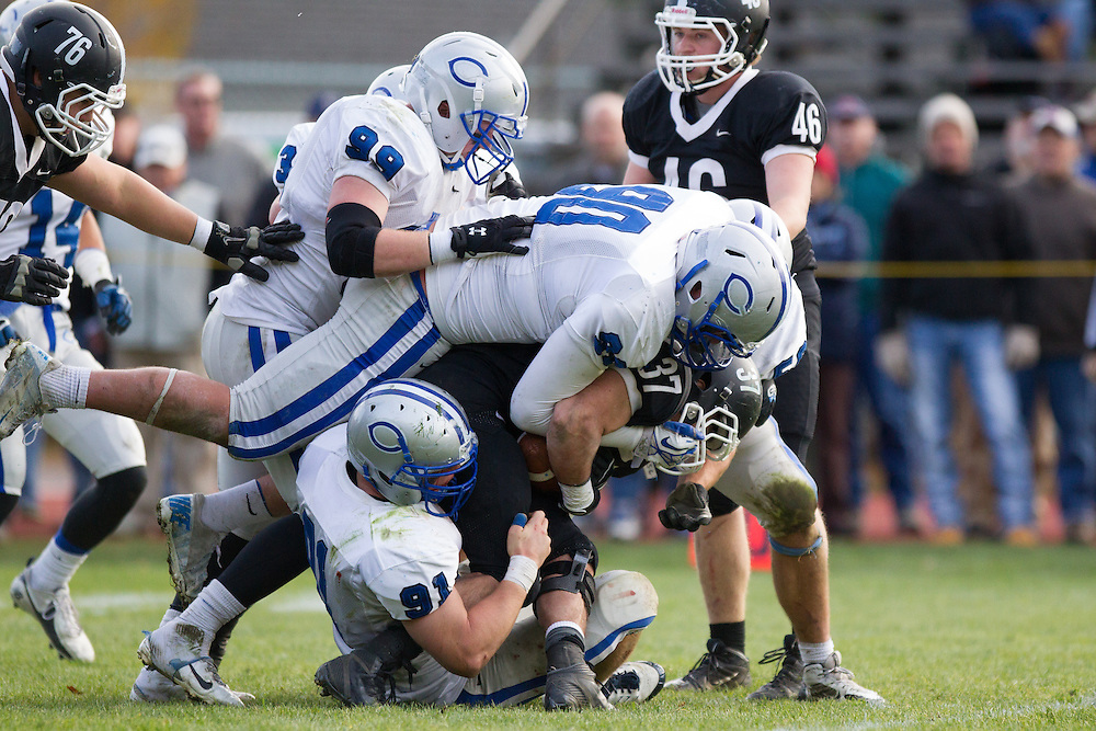 Stephen O'Grady and Chris Marano, of Colby College, during a NCAA Division III football game against Bowdoin College on November 9, 2013 in Waterville, ME. (Dustin Satloff/Colby College Athletics)