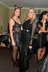 Left to right, KATIE READMAN and ALICE NAYLOR-LEYLAND at the Bumpkin Halloween Dinner hosted by Marissa Hermer held at Bumpkin, 119 Sydney Street, London on 23rd October 2014.