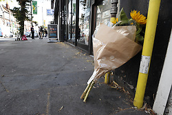 © Licensed to London News Pictures. 12/07/2019. London, UK. Flowers are placed at the scene where a mass brawl took place in Purley, south London where a teenager was murdered and two others were injured, including the murder suspect, in a stabbing last night. Photo credit: Peter Macdiarmid/LNP