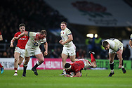 England's Dylan Hartley (with bloodied face) and Owen Farrell ® try to stop a breakaway from Aaron Shingler of Wales © who slips to the ground. England v Wales, NatWest 6 nations 2018 championship match at Twickenham Stadium in Middlesex, England on Saturday 10th February 2018.<br /> pic by Andrew Orchard, Andrew Orchard sports photography