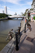 Singapore. Kids Jumping in the Singapore River Statue by Chong Fah Cheong .