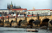 """SHOT 11/21/08 7:45:13 AM -  The Prague Castle and Charles Bridge in Prague, Czech Republic. Prague Castle (Czech: Pra?ský hrad) is a castle in Prague where the Czech kings, Holy Roman Emperors and presidents of Czechoslovakia and the Czech Republic have had their offices. The Czech Crown Jewels are kept here. Prague Castle is one of the biggest castles in the world (according to Guinness Book of Records the biggest ancient castle) at about 570 meters in length and an average of about 130 meters wide. Charles Bridge is a famous historical bridge that crosses the Vltava river in Prague, Czech Republic. The bridge is 516 meters long and nearly 10 meters wide, resting on 16 arches shielded by ice guards. It is protected by three bridge towers, two of them on the Lesser Quarter side and the third one on the Old Town side. The Old Town bridge tower is often considered to be one of the most astonishing civil gothic-style buildings in the world. The bridge is decorated by a continuous alley of 30 statues and statuaries, most of them baroque-style, erected around 1700. Prague is the capital and largest city of the Czech Republic. Its official name is Hlavní m?sto Praha, meaning Prague, the Capital City. Situated on the River Vltava in central Bohemia, Prague has been the political, cultural, and economic centre of the Czech state for over 1100 years. The city proper is home to more than 1.2 million people, while its metropolitan area is estimated to have a population of over 1.9 million. Since 1992, the extensive historic centre of Prague has been included in the UNESCO list of World Heritage Sites. According to Guinness World Records, Prague Castle is the largest ancient castle in the world. Nicknames for Prague have included """"the mother of cities"""", """"city of a hundred spires"""" and """"the golden city"""". Since the fall of the Iron Curtain, Prague has become one of Europe's (and the world's) most popular tourist destinations. It is the sixth most-visited European city after London"""