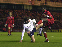 Photo. Glyn Thomas.<br /> Middlesbrough v Tottenham Hotspur.<br /> FA Barclaycard Premiership.<br /> Riverside Stadium, Middlesbrough. 09/03/2004.<br /> Middlesbrough's Joseph Job (R) is prevented from getting a shot in on goal by Darren Anderton (C) as Juninho looks on.