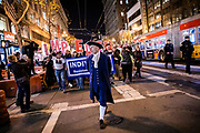 """SAN FRANCISCO, CA - DECEMBER 17: Event organizer Steven Rapport leads a crowd of several hundred protesters while dressed as founding father Alexander Hamilton during demonstrations in part of a national impeachment rally, down Market Street in San Francisco, California on December 17, 2019. Protesters around the nation participated in """"Nobody is Above the Law"""" rallies on the eve of a historic Trump impeachment vote in the United States House of Representatives. (Photo by Philip Pacheco/AFP)"""