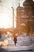 Woman crossing road in Tynda, Amur region. Siberia, Russia