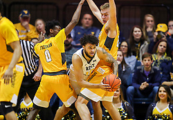 Nov 24, 2018; Morgantown, WV, USA; West Virginia Mountaineers guard Jermaine Haley (10) passes the ball between Valparaiso Crusaders defenders during the first half at WVU Coliseum. Mandatory Credit: Ben Queen-USA TODAY Sports