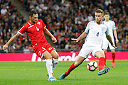 England Midfielder Jordan Henderson makes Malta Midfielder Gareth Sciberras play out from the back during the FIFA World Cup Qualifier match between England and Malta at Wembley Stadium, London, England on 8 October 2016. Photo by Andy Walter.