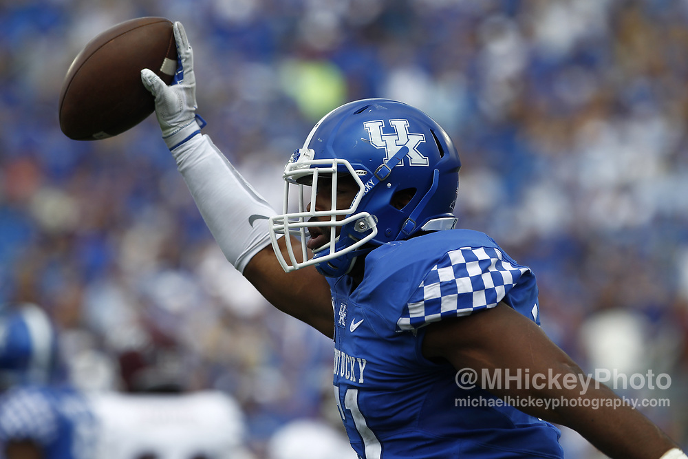 LEXINGTON, KY - SEPTEMBER 09: Courtney Love #51 of the Kentucky Wildcats celebrates after an Eastern Kentucky Colonels turnover at Kroger Field on September 9, 2017 in Lexington, Kentucky. (Photo by Michael Hickey/Getty Images) *** Local Caption *** Courtney Love