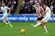 Swansea's Jack Cork (24) passes as Southampton's Oriol Romeu watches on. Barclays Premier league match, Swansea city v Southampton at the Liberty Stadium in Swansea, South Wales on Saturday 13th February 2016.<br /> pic by  Carl Robertson, Andrew Orchard sports photography.
