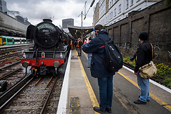 © Licensed to London News Pictures. 20/05/2021. London, UK. Train enthusiasts take photographs of The LNER Flying Scotsman steam locomotive at Victoria Station in central London ahead of a tour through the Surrey Hills in South east England. The heritage steam locomotive touring season was mostly cancelled last year due to the Covid-19 pandemic but is now underway as restrictions are eased. Built in 1923 for the London and North Eastern Railway (LNER)It was the first steam locomotive to reach 100 miles per hour . Photo credit: Ben Cawthra/LNP