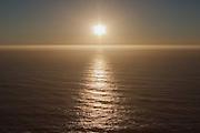 Sun setting over pacific ocean, Big Sur, California