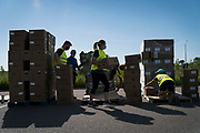 Volunteers hand out boxes of groceries to residents at Prairie Winds Middle School in Mankato Minnesota, U.S., on Thursday, July 23, 2020. Photographer: Ben Brewer/Bloomberg