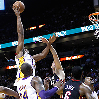 10 March 2011: Los Angeles Lakers center Andrew Bynum (17) goes for the skyhook over Miami Heat center Zydrunas Ilgauskas (11) during the Miami Heat 94-88 victory over the Los Angeles Lakers at the AmericanAirlines Arena, Miami, Florida, USA.