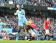 Marcos Rojo of Manchester United brings down Yaya Toure of Manchester City in the penalty area - Barclays Premier League - Manchester City vs Manchester Utd - Etihad Stadium - Manchester - England - 2nd November 2014  - Picture David Klein/Sportimage