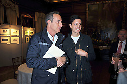 Left to right, SIMON ASTAIRE and his son MILO ASTAIRE at an exhibition of photographs by Edgar Astaire held at The Royal Hospital Chelsea, London on 24th April 2009.