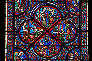 Medieval Windows  of the Gothic Cathedral of Chartres, France, dedicated to the life an miracles of St Nicholas. A UNESCO World Heritage Site. Bottom corner shows During a famine, Nicholas persuades sailors to give the town some grain, bottom left shows The sailors bringing grain ashore . Centre panel bottom, The young St Nicholas does well at school, left Nicholas secretly gives gold to an old man to save his daughters , right The old man tries to thank Nicholas, who humbly flees from him, top .Nicholas is chosen to be the new Bishop of Myra. .<br /> <br /> Visit our MEDIEVAL ART PHOTO COLLECTIONS for more   photos  to download or buy as prints https://funkystock.photoshelter.com/gallery-collection/Medieval-Middle-Ages-Art-Artefacts-Antiquities-Pictures-Images-of/C0000YpKXiAHnG2k