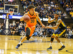 Feb 10, 2018; Morgantown, WV, USA; Oklahoma State Cowboys guard Jeffrey Carroll (30) drives to the basket during the first half against the West Virginia Mountaineers at WVU Coliseum. Mandatory Credit: Ben Queen-USA TODAY Sports