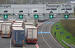 © Licensed to London News Pictures. 25/11/2020. <br /> Folkestone, UK. Freight lorries travelling to Europe could see more customs border checks. Lorries queuing today at the Channel Tunnel freight terminal in Folkestone, Kent. This lorry driver is urinating at the side of the road. When the Brexit transition period ends on December 31st 2020 new rules will apply to people travelling to and from Europe with some rules subject to ongoing UK an EU negotiations. Photo credit:Grant Falvey/LNP