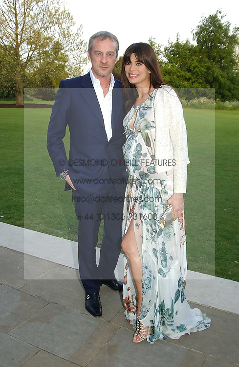 Model LISA BARBUSCIA and her husband ANTON BILTON at 'Horticouture' a charity fashion show to raise funds for Tommy's, the baby charity and The Royal Botanic Gardens, Kew held at Kew on 12th May 2005.<br /><br />NON EXCLUSIVE - WORLD RIGHTS