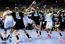 Jure Dolenec of Slovenia vs Hendrik Pekeler of Germany during handball match between National Teams of Germany and Slovenia at Day 2 of IHF Men's Tokyo Olympic  Qualification tournament, on March 13, 2021 in Max-Schmeling-Halle, Berlin, Germany. Photo by Vid Ponikvar / Sportida