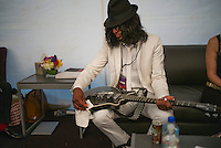Guitarist Kellindo Parker backstage at the Global Citizen's Festival in New York's Central Park. <br /> <br /> <br /> The free, ticketed event is part of the Global Citizen platform, a social media and live-event campaign. Musicians and celebrities join dignitaries and philanthropists to urge world leaders to act towards ending extreme poverty by 2030. Free tickets were earned by fans who logged on to www.globalfestival.com to learn and share content about four main themes: education, women's equality, global health and global partnerships.<br /> <br /> (Photo by Robert Caplin) 2013 Global Citizen's Festival. <br /> <br /> Photo ©Robert Caplin