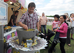© licensed to London News Pictures. LONDON. UK.  01/07/11. Jamie Oliver tastes guacamole at the festival in Clapham Common. Jamie Oliver's The Big Feastival, is a three day event featuring food from some of the country's top chefs along with live music. The Big Feastival takes place on Clapham Common on the 1st, 2nd and 3rd July. All profits from the event will be shared between The Jamie Oliver Foundation and The Prince's Trust.  Mandatory Credit Stephen Simpson/LNP