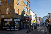 Brick Lane in East London. March 24th 2020 was the first day of enforced lockdown in the UK, in order to stop the spread of the Coronavirus Covid 19. On what would normally be a bustling business / week day in London, the city was deserted, with just a few people in masks out on the street, plus a few taxis and mostly empty buses.