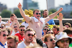 © Licensed to London News Pictures. 13/06/2021. London, UK. Fans celebrate at Skylight Rooftop, Tobacco Dock in London, after England win 1- 0 against Croatia in their Euro 2020 game. Photo credit: Dinendra Haria/LNP