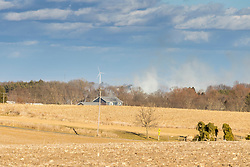 An empty field where many collected fallen leaves had been dumped catches fire and burns in Danvers Township near Jollys Lake and Apollo Acres.  The fire, fueled by 30 to 35 mph winds created a smoke plume that could be seen for at least 25 miles.