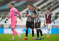 Football - 2021 / 2021 Premier League - Newcastle United vs Burnley - St Jame's Park<br /> <br /> Jeff Hendrick of Newcastle United and Emil Krafth of Newcastle United celebrate at full time<br /> <br /> COLORSPORT/BRUCE WHITE