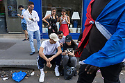 French nationals sit on the floor to watch to watch the match between France and Croatia in the World Cup Final. Paris, France.