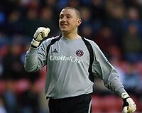 Photo: Paul Greenwood.<br />Wigan Athletic v Sheffield United. The Barclays Premiership. 16/12/2006. Sheffield goalkeeper Paddy Kenny celebrates taking the lead