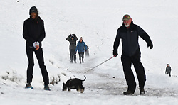 © Licensed to London News Pictures. 04/12/2020. <br /> People struggle through the win on Penyfan, in the Brecon Beacons, the highest point in southern Wales and England, which has seen it's first snowfall of the year. Photo credit: Robert Melen/LNP