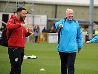 Football - 2018 / 2019 FA Cup - Third Round: Woking vs. Watford<br /> <br /> Sky Sports commentator and Woking coach, Martin Tyler, with Watford's Troy Deeney before the match at Kingfield Stadium.<br /> <br /> COLORSPORT/ANDREW COWIE