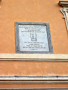 View of a sign on a wall in the Piazza di Spagna located at the bottom of the Spanish Steps. Rome. Italy 2014