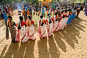 Sri Lanka. Womens festival at Udappuwa. The first festival after the Sinhala Tamil New year, in the hot month of April or May. They dance in groups around a shrine at night and the next morning. On the Wednesday* morning, they all converge on the beach, carrying with them pots with seedlings and end the celebration with an offering to the sea. An adaptation of a harvest & rain festival, at this fishing community the prayer is for a better catch from the sea. .*The festival is always on a Tuesday evening and Wednesday morning.<br /> Sri Lanka.