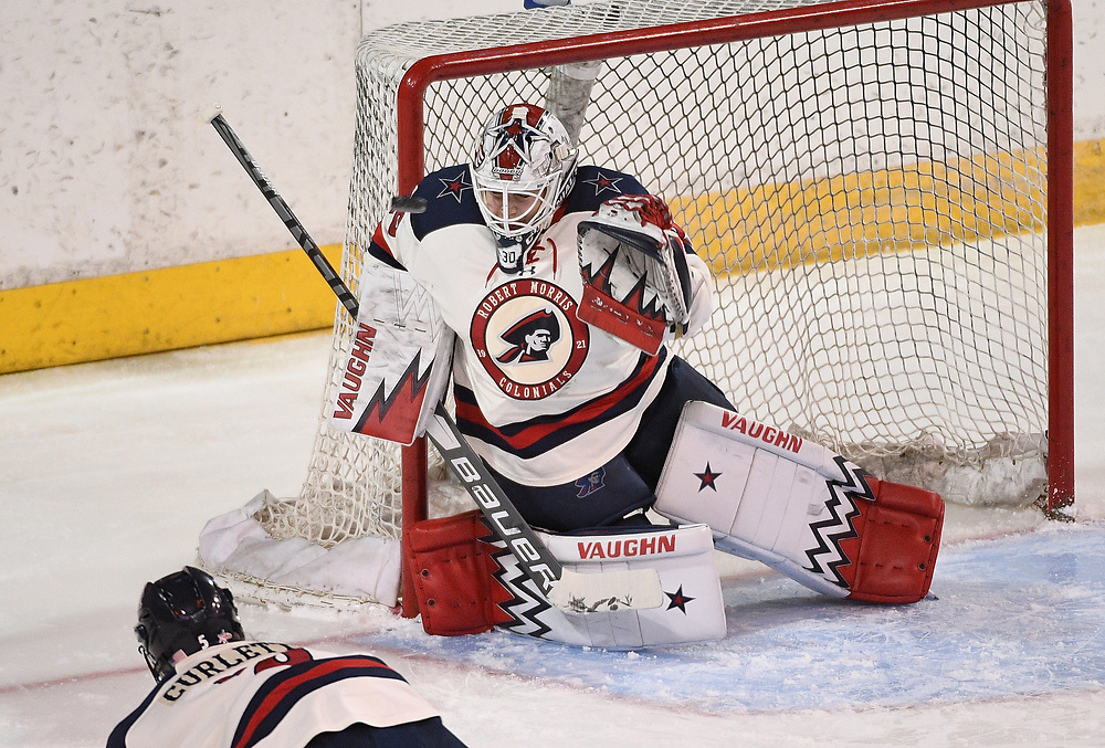 ERIE, PA - MARCH 04: Molly Singewald #30 of the Robert Morris Colonials tends goal in the second period during the game against the RIT Tigers at the Erie Insurance Arena on March 4, 2021 in Erie, Pennsylvania. (Photo by Justin Berl/Robert Morris Athletics)