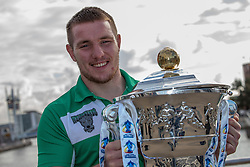 © Licensed to London News Pictures . 26/10/2012 . Salford , UK . Matty Hadden of Ireland holds the cup . Press conference marking a one year countdown to the start of the 2013 Rugby League World Cup , which is being hosted by England and Wales . Photo credit : Joel Goodman/LNP