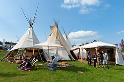 © Licensed to London News Pictures. 29/05/2016. Hay-on-Wye, Powys, Wales, UK. Festival-goers relax in the wigwam style Kata tents. Beautiful weather on the fourth day of the 'HowTheLightGetsIn' Festival of Ideas at Hay-on-Wye, Wales. Photo credit: Graham M. Lawrence/LNP
