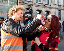 A face painter painting a Welsh dragon on a Wales fan<br /> <br /> Photographer Simon King/Replay Images<br /> <br /> Under Armour Series - Wales v Tonga - Saturday 17th November 2018 - Principality Stadium - Cardiff<br /> <br /> World Copyright © Replay Images . All rights reserved. info@replayimages.co.uk - http://replayimages.co.uk
