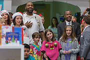Former Neurosurgeon and Republican presidential candidate Dr. Ben Carson enjoys Christmas carols with patients and staff during a visit to the MUSC Children's Hospital December 22, 2015 in Charleston, South Carolina. Carson stopped by to listen to Christmas carols and greet the young patients.