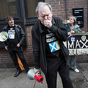 Sean Clerkin (C) of the Scottish Resistance after speaking at a demo in Cadogan Street, Glasgow. With fellow members James Scott (L) and Alicia MacKenzie (R). Picture Robert Perry 29th Jan 2016<br /> <br /> Must credit photo to Robert Perry<br /> FEE PAYABLE FOR REPRO USE<br /> FEE PAYABLE FOR ALL INTERNET USE<br /> www.robertperry.co.uk<br /> NB -This image is not to be distributed without the prior consent of the copyright holder.<br /> in using this image you agree to abide by terms and conditions as stated in this caption.<br /> All monies payable to Robert Perry<br /> <br /> (PLEASE DO NOT REMOVE THIS CAPTION)<br /> This image is intended for Editorial use (e.g. news). Any commercial or promotional use requires additional clearance. <br /> Copyright 2014 All rights protected.<br /> first use only<br /> contact details<br /> Robert Perry     <br /> 07702 631 477<br /> robertperryphotos@gmail.com<br /> no internet usage without prior consent.         <br /> Robert Perry reserves the right to pursue unauthorised use of this image . If you violate my intellectual property you may be liable for  damages, loss of income, and profits you derive from the use of this image.