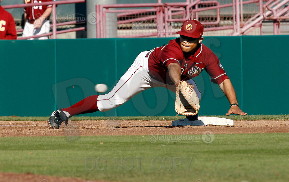 24 February 2007: #39 Derek Perren dives at first base to make a catch for the USC Trojans College Baseball defeated the No. 21 Tulane Green Wave, 4-3, at Dedeaux Field on campus in Los Angeles, CA.
