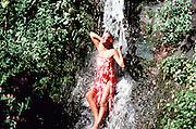 Woman under Waterfall, Nuuanau, Honolulu, Oahu, Hawaii