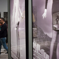 Visitors walk at the exhibition of american fashion photographer Helmut Newton in Budapest, Hungary on April 02, 2013. ATTILA VOLGYI